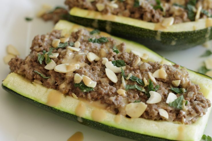 Lebanese zucchini boats garnished with fresh mint and sliced almonds