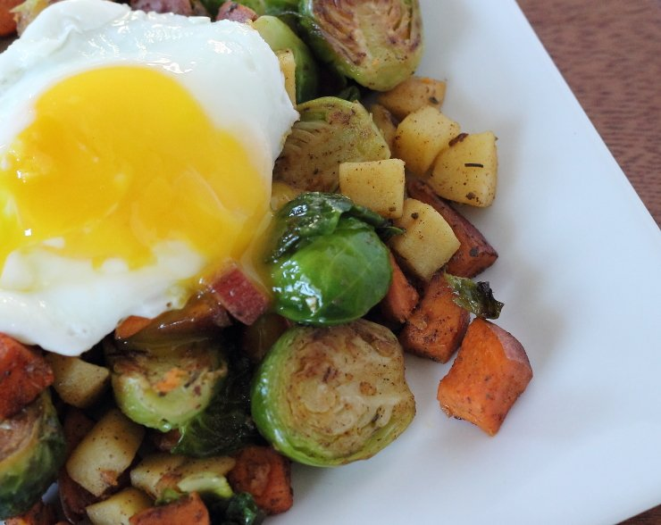 Egg topped apple, sweet potato, brussels sprouts breakfast hash. The ultimate healthy breakfast to power through your day.