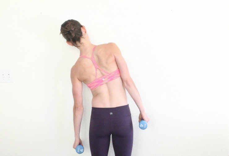 Side-to-Side weighted reaches target lower back fat and sculpt your waist