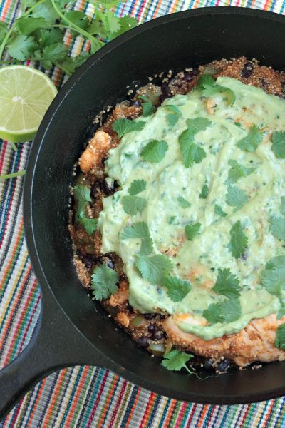 One-Pot Quinoa and Chicken Enchilada Skillet with Avocado Cream