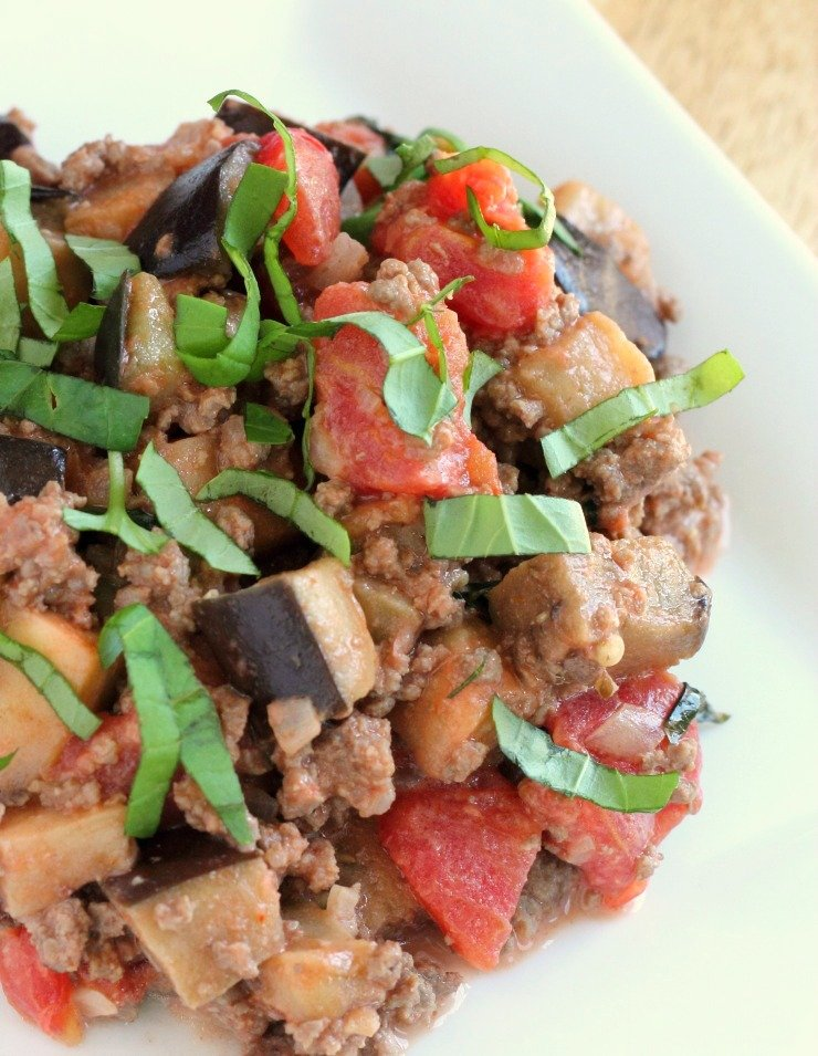 Whole30 compliant meal in 30 minutes or less. An amazing tomato basil base for ground beef and sautéed eggplant.