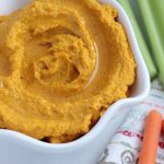 Roasted carrots and caramelized cauliflower with a tahini base makes the best beanless hummus. Slightly sweet and a little smoky - the perfect whole30 party snack!