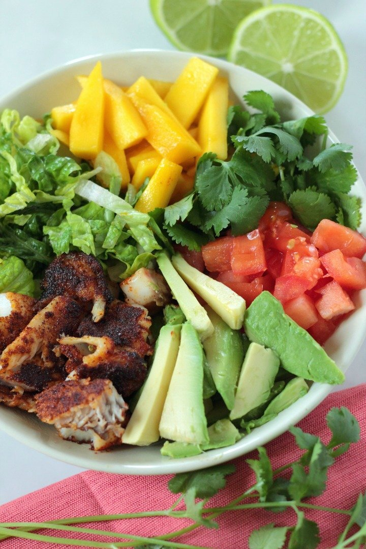 These blackened fish taco salad bowls are the perfect whole30, paleo, low-carb lunch. Sweet mangos, creamy avocado, fresh cilantro, and spicy fish make a complex and flavorful salad!