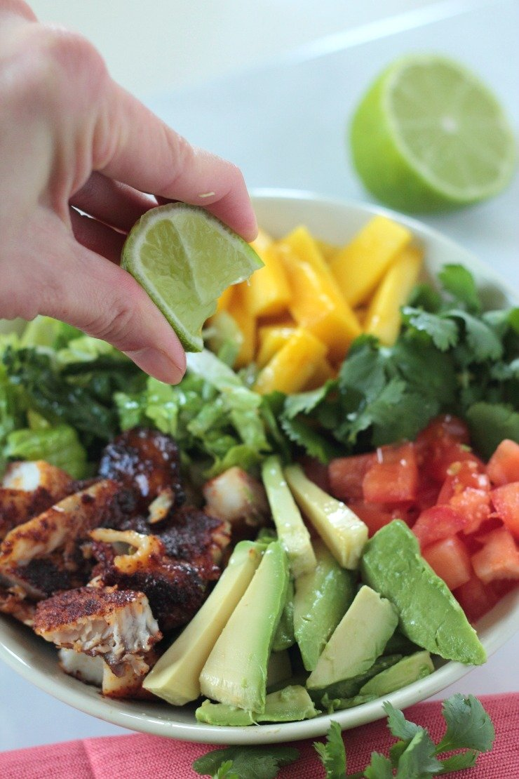 Topped with a little olive oil and lime, these blackened fish taco salad bowls are a favorite lunchtime salad and so easy to make!
