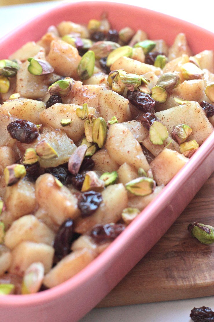 Juicy pears, sweet raisons, raw honey, and crunch pistachios complete this paleo dessert for two! Pear and Raisin Compote with Crushed Pistachios