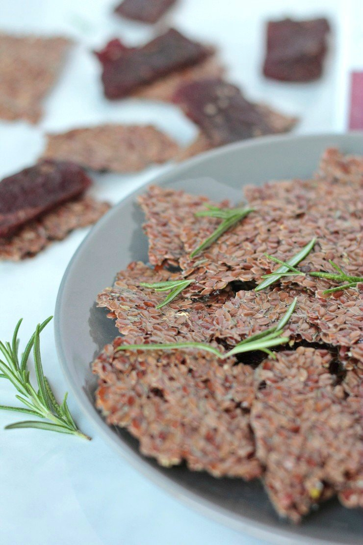 These paleo, whole30, vegan lemon rosemary flaxseed crackers are so easy make and have the perfect crunch for the best homemade crackers ever!