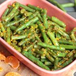 These mandarin orange glazed green beans are a delicious and light side dish made in 10 minutes! Vegan, paleo, and Whole30 compliant