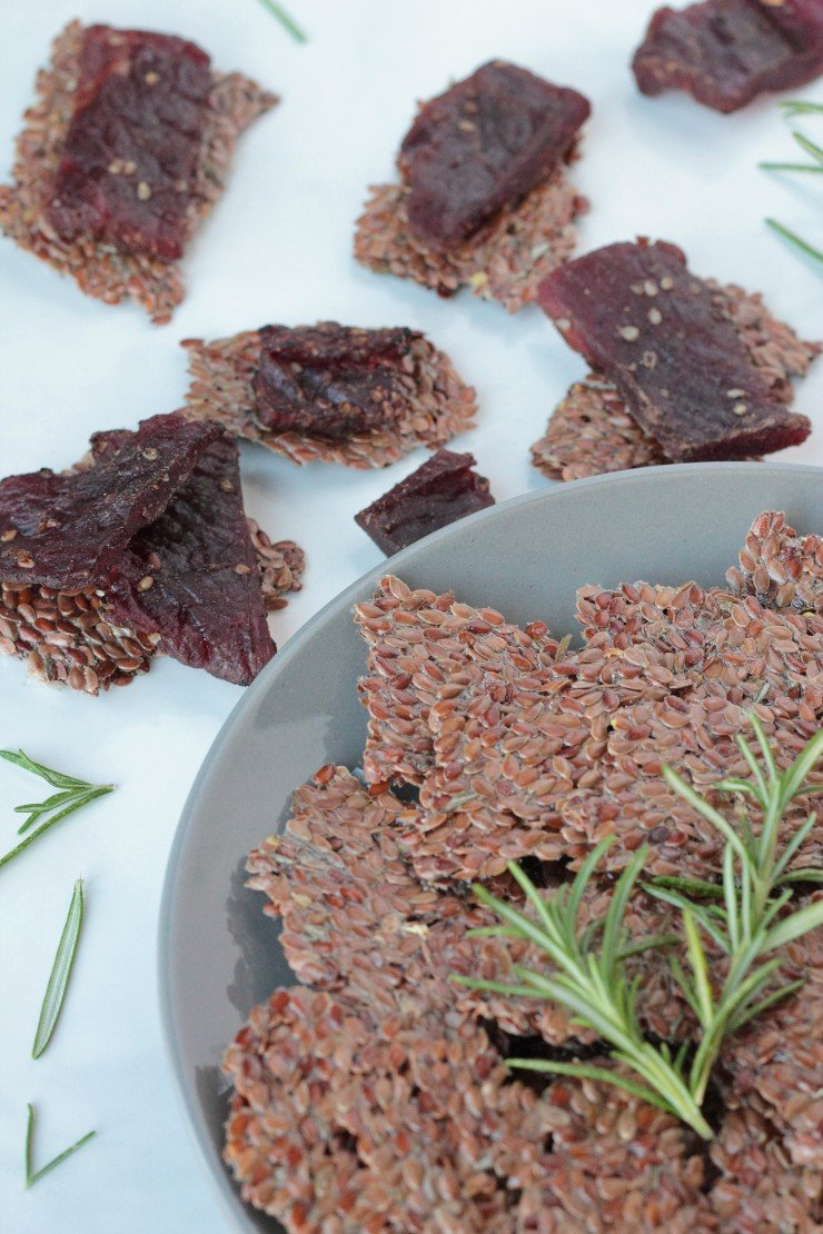 Paleo and vegan flaxseed crackers are so easy to make. You must try these lemon rosemary flaxseed crackers!
