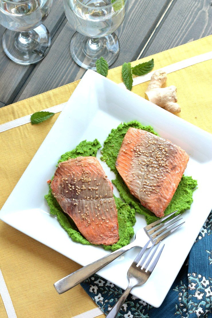 This gluten-free, dairy-free healthy salmon dinner has an Asian-inspired marinade over an amazing ginger mint pea puree. So many flavors for a seriously delicious and elegant dinner!