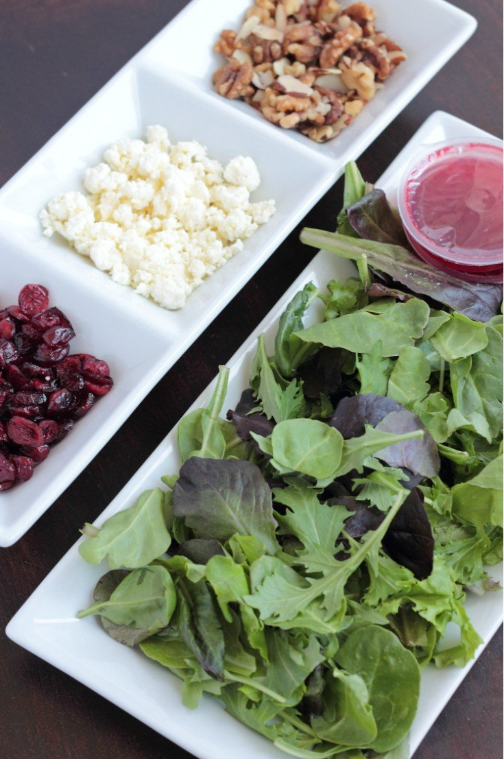 Invited over for dinner? Need a side to share? Using pre-packaged salads can make life SO easy and impress all dinner guests!