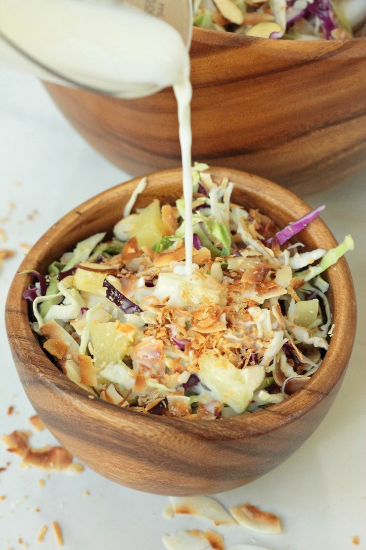 This vegan, whole30 compliant coleslaw recipe is made with a coconut milk, pineapple juice, and apple cider vinegar dressing that is amazing!