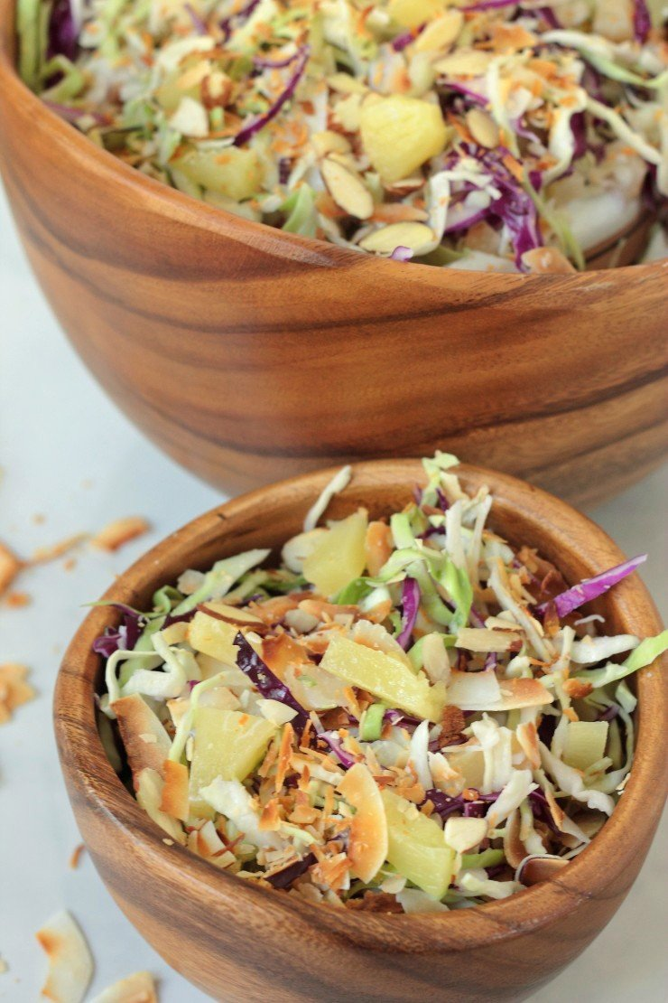 This Whole30 compliant cole slaw is tropical, crunchy, and delicious. If you love pina coladas, this is your summer side dish!
