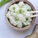 Sick of boring cauliflower rice? Try this coconut ginger cauliflower rice and check out all the ways to incorporate it in to a dish! So easy, Whole30 compliant, and vegan!