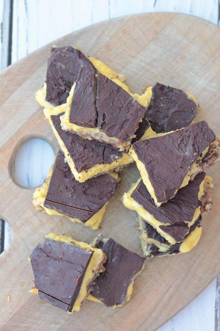 A cool treat straight from the freezer - no bake paleo chocolate mango bars. That sweet chocolate with a tart middle is just what you need for a decadent gluten-free, dairy-free treat!
