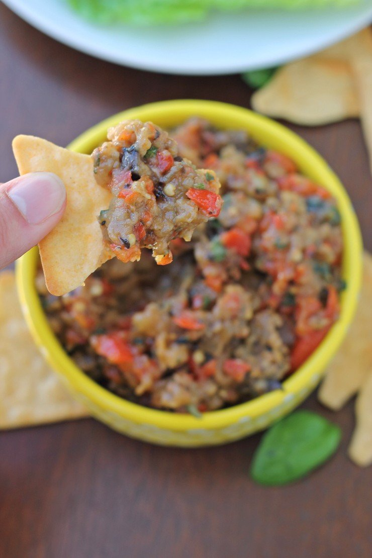 Need a clean and healthy dip for your next party? Try this roasted red pepper and eggplant tapenade. It's whole30 complaint, paleo, and vegan!
