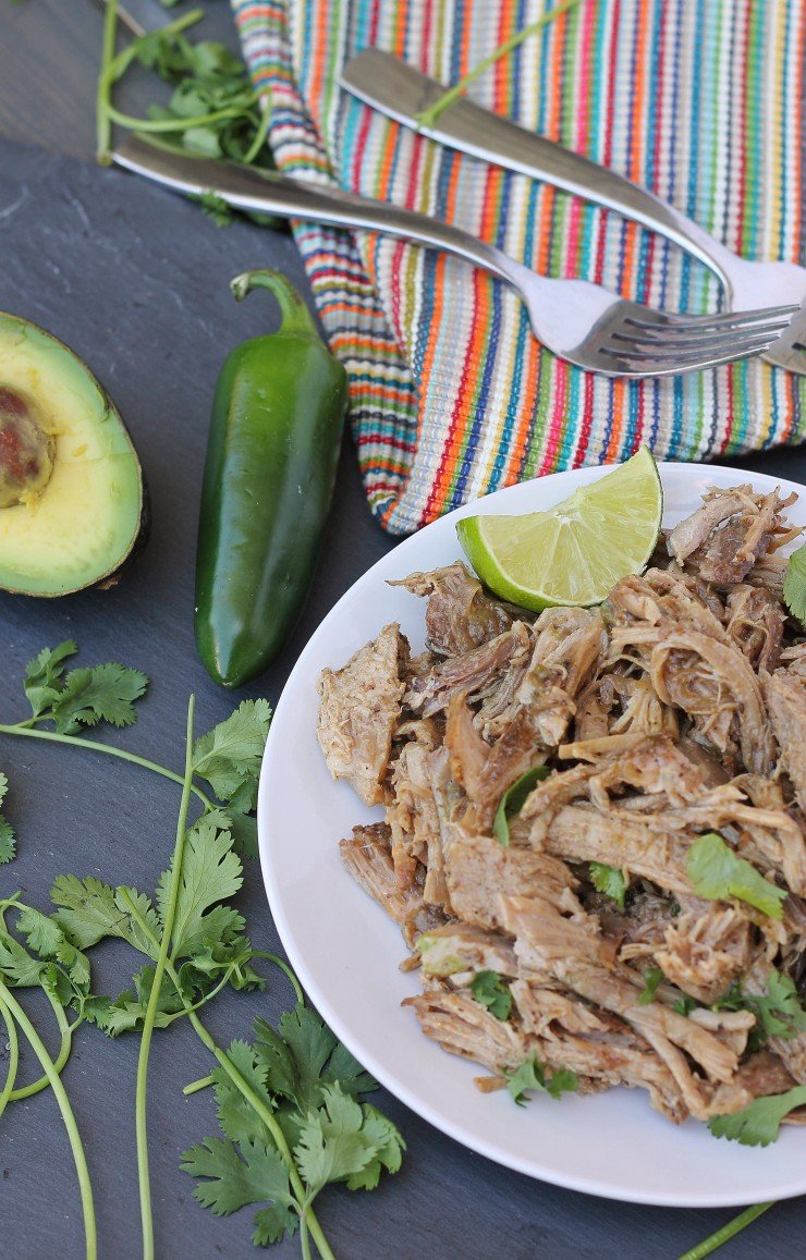 Chili powder, cumin, and oregano combined with onions, lime juice, and diced jalepeno is all you need for the BEST whole30 compliant slow cooker pork carnitas ever!