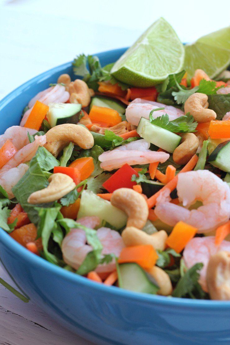 Cocktail shrimp, peppers, carrots, cucumbers, and cilantro make this Thai shrimp salad. Top with crunchy nuts and an almond butter dressing and you have a winning lunch or dinner!