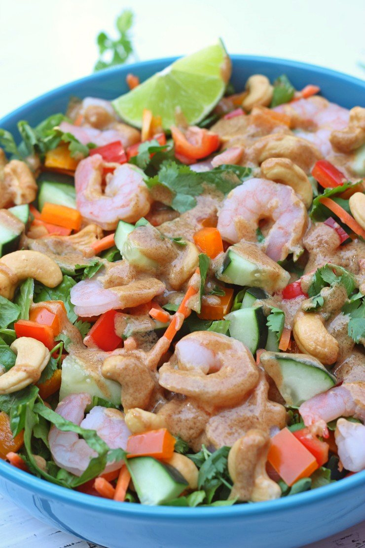 This whole30 compliant Thai salad with shrimp has an amazing almond dressing you can't miss. Almond butter, coconut aminos, lime, sesame oil, and rice vinegar give this salad some serious flavor flair!