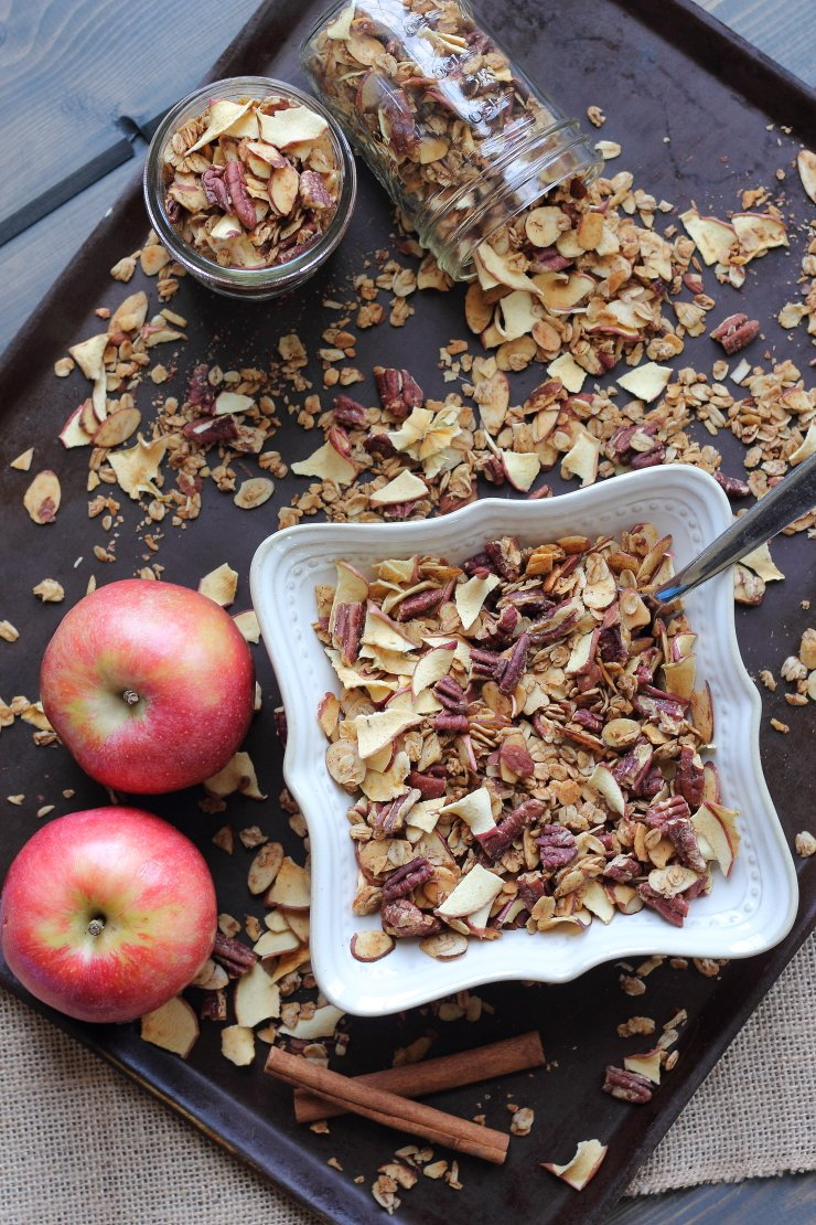 Clean and healthy - this apple pie granola is SO easy to make, and literally bursting with spiced apple flavor. WITHOUT any refined sugar. It's a must try for apple lovers.