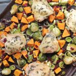 This paleo and whole30 sheet pan chicken meal is made with roasted sweet potatoes, brussels sprouts, leeks, and dried cranberries. Just 30 minutes for the perfect healthy fall meal