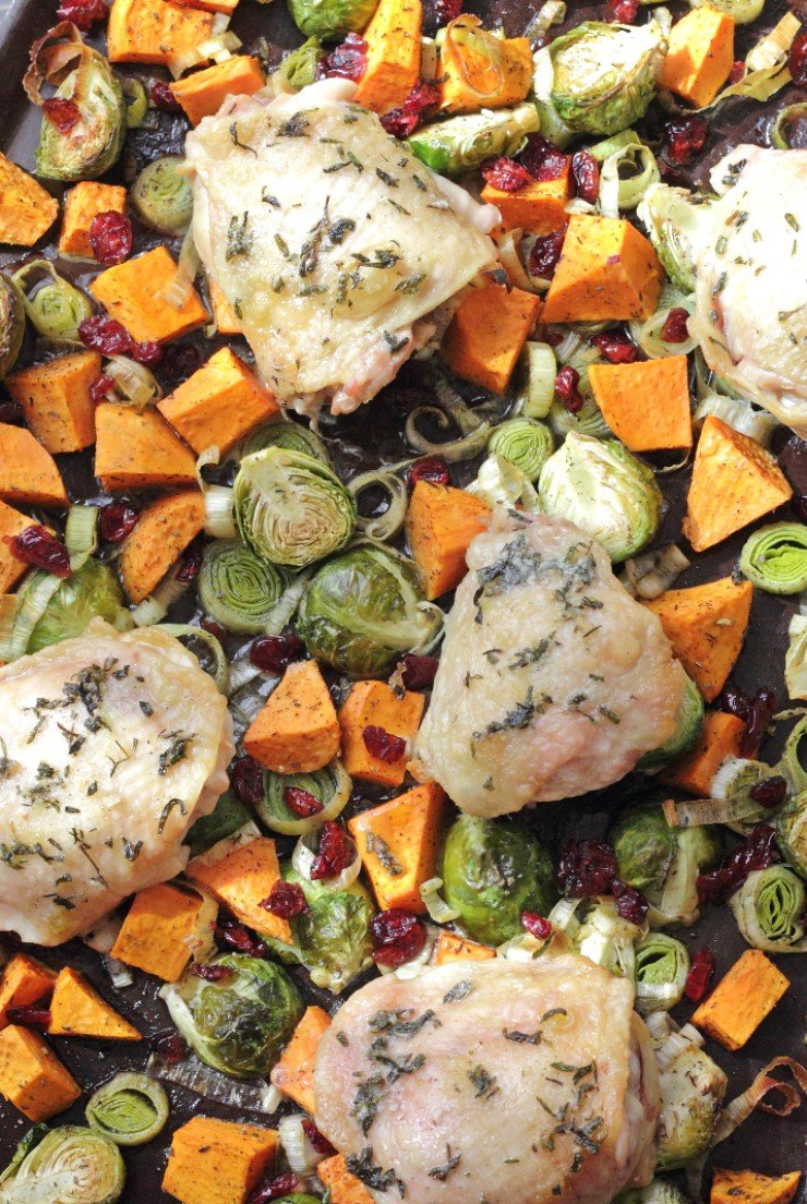 Seriously the BEST 30-minute fall meal. Roasted veggies combined with craisins, topped with chicken thighs. It's paleo and whole30 compliant too!