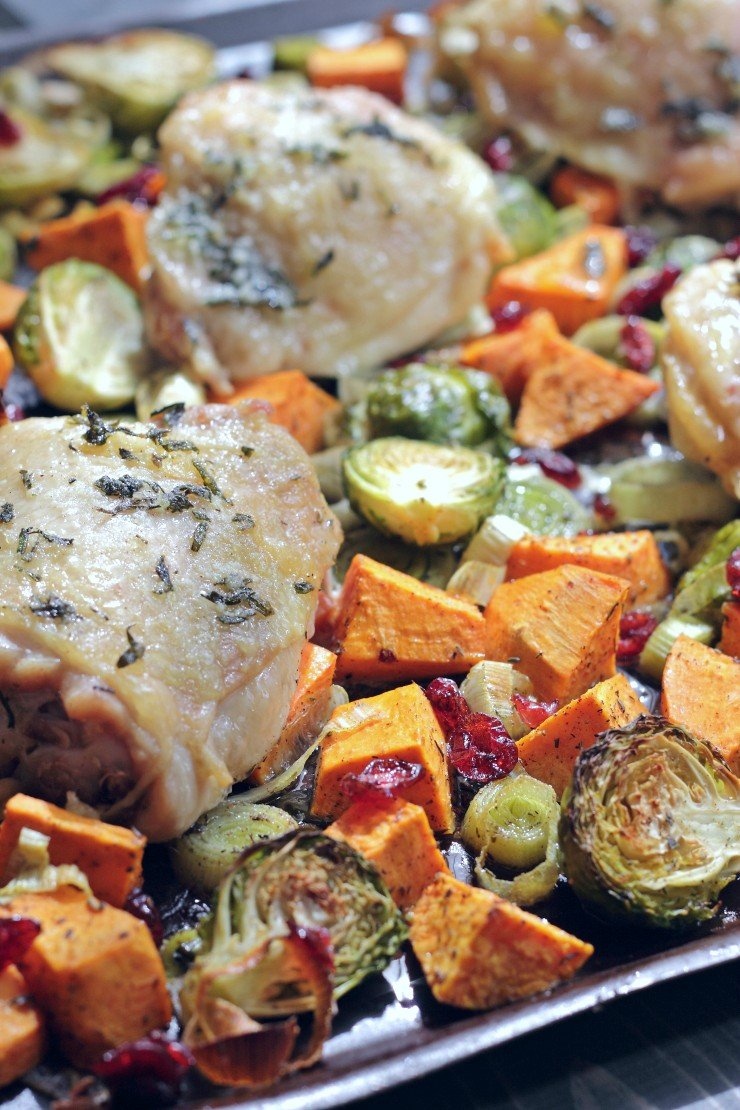 Sweet potatoes, leeks, brussels sprouts and dried cranberries roasted with chicken thighs makes a full flavor, easy weekday meal. Paleo and Whole30 compliant