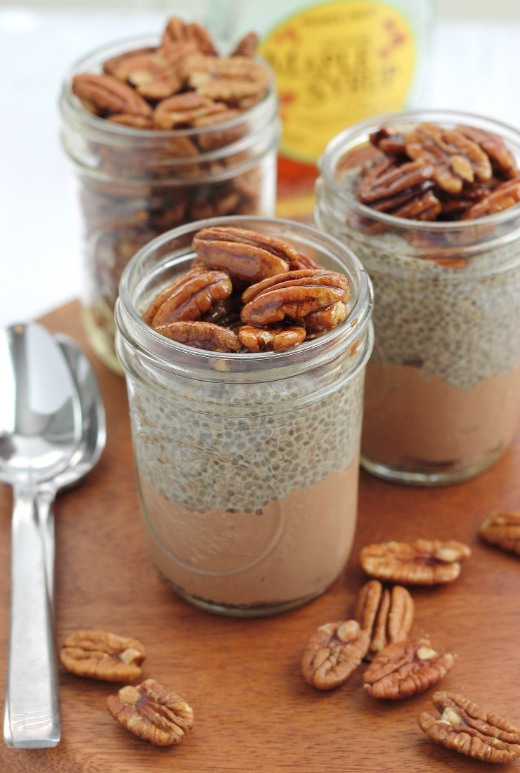 These chia seed pudding parfaits are inspired by chocolate pecan pie! Made with a chocolate pudding base, spiced chia seed pudding, and a sticky, sweet, and crunchy pecan top. Vegan & paleo