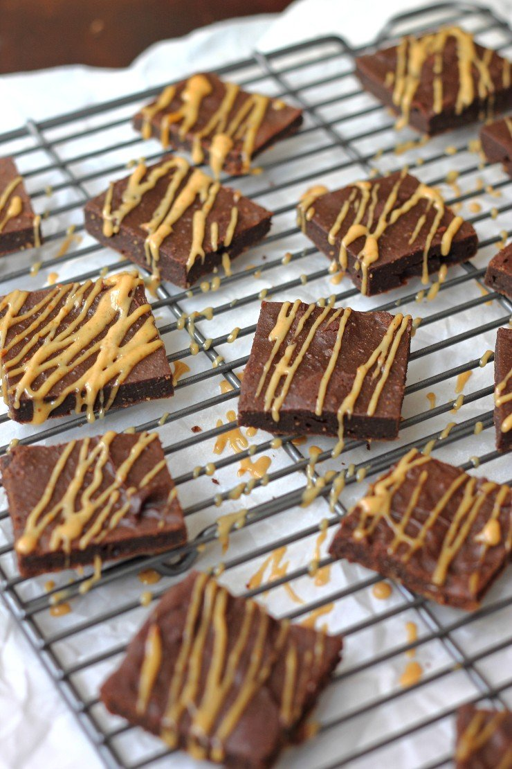 The best gluten free, dairy free brownies out there! The batter is made with peanut butter, cocoa powder, and honey. You HAVE to try these and drizzle that peanut butter maple glaze ALL over them!