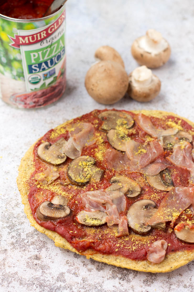 A paleo pizza that's WAY easier than cauliflower crust. This plantain crust take just seconds to make and minutes to bake!