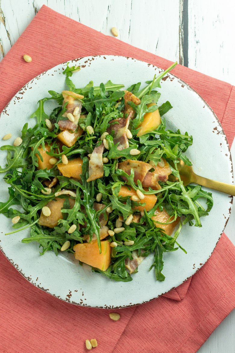 A perfect paleo salad with bacon, pine nuts, and candied cantaloupe!