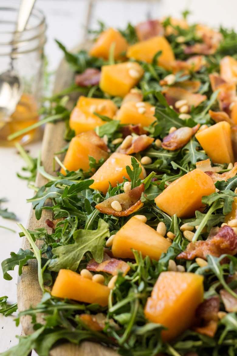 A paleo salad unlike any other! The savory bacon and sweet candied cantaloupe combine beautifully for a party favorite!