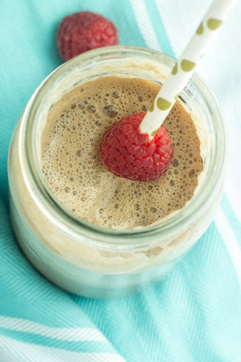 Just a few ingredients make up this raspberry protein frappuccino. Clean and healthy