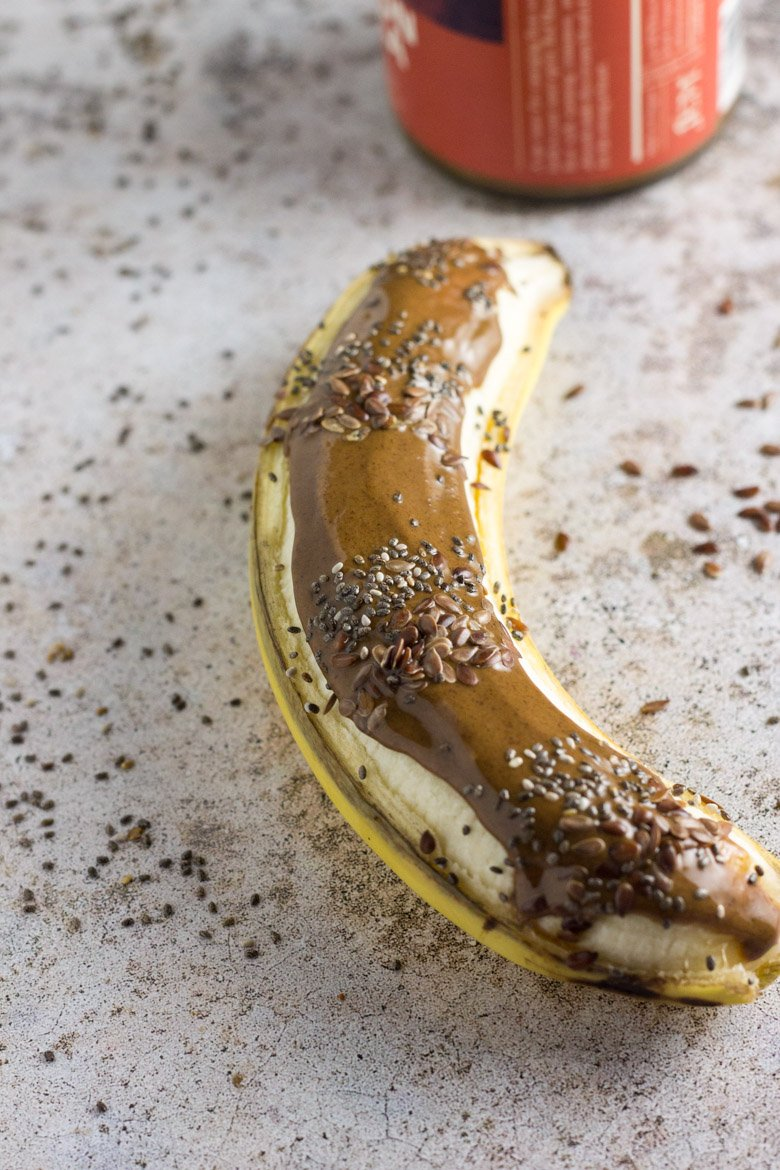 Packed with potassium, omega-3's, and healthy fat, this seedy almond butter breakfast banana boat is the perfect way to start the day!