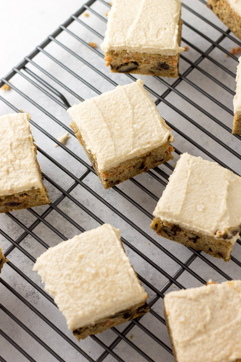 Gluten-free, dairy-free, and naturally sweetened carrot cake bars with a sweet, salted cashew cream cheese frosting. Paleo