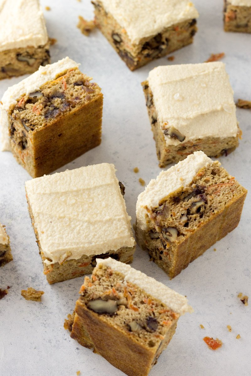 Naturally sweetened, gluten free, and dairy free - these paleo carrot cake bars have the most decadent cashew frosting! And easy to make!