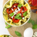 A healthy breakfast solution that can be made beforehand! These savory roasted red pepper and goat cheese omelette bowls are bursting with rich flavor! Omit the cheese for a Whole30 option!