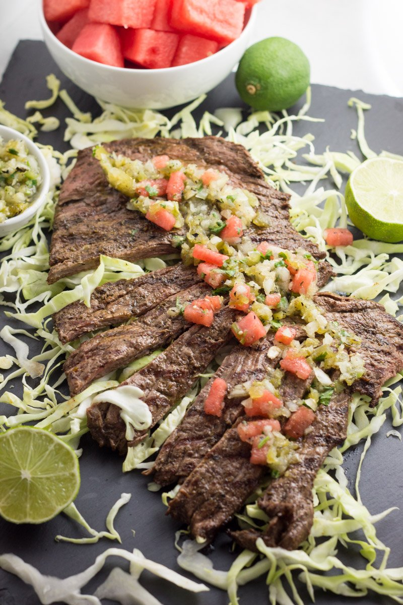 This carne asada with tomatillo watermelon salsa is the perfect quick and easy meal that's paleo and whole30 compliant! Perfect to feed a crowd!