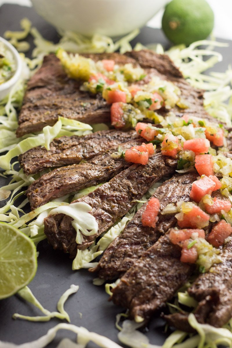 Carne asada steak with tomatillo watermelon salsa - a unique twist on a grilling favorite! Whole30, paleo