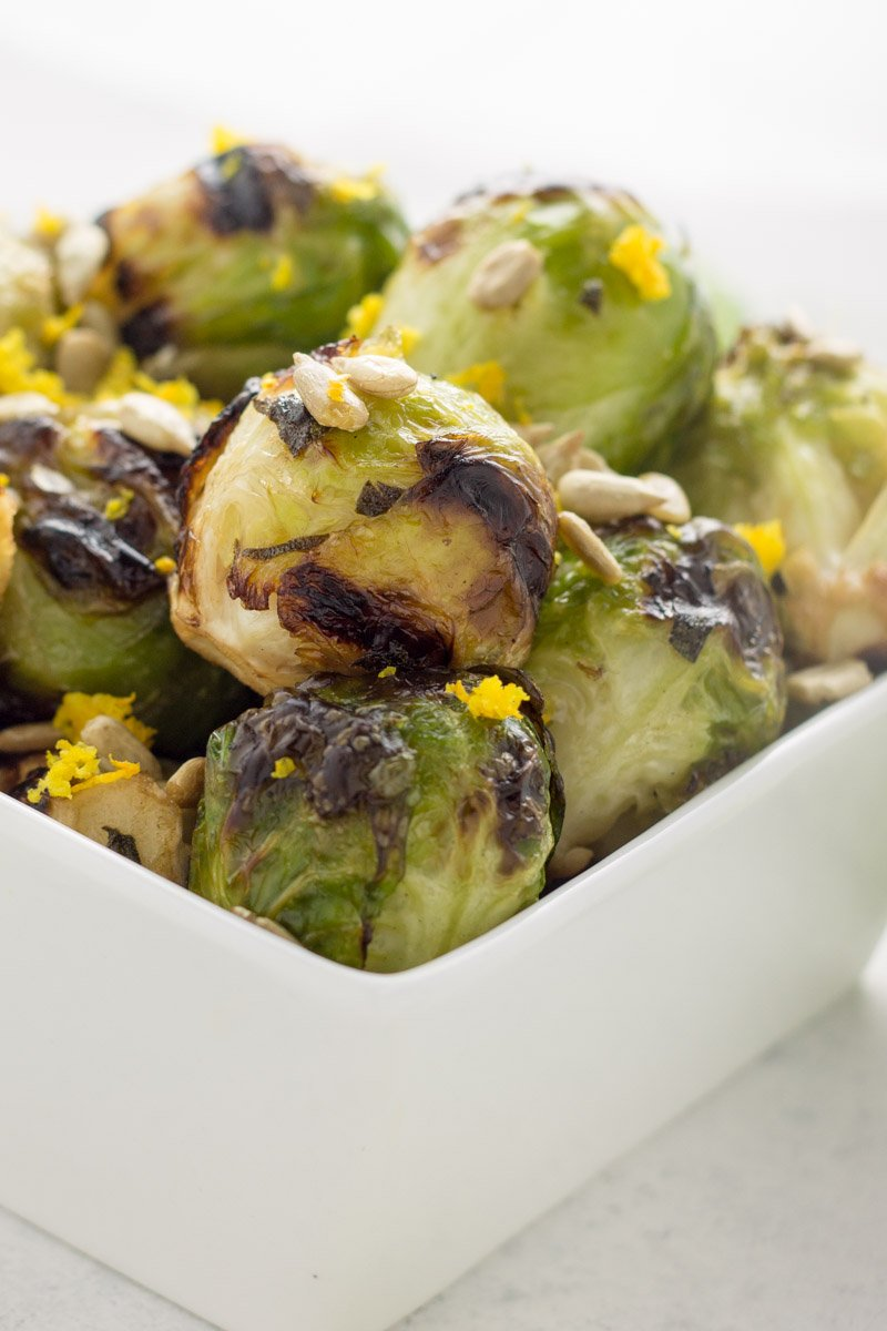 Perfect grilled brussels sprouts - this Whole30 compliant summer veggie side dish is packed with flavor to jazz up your brussels sprouts!