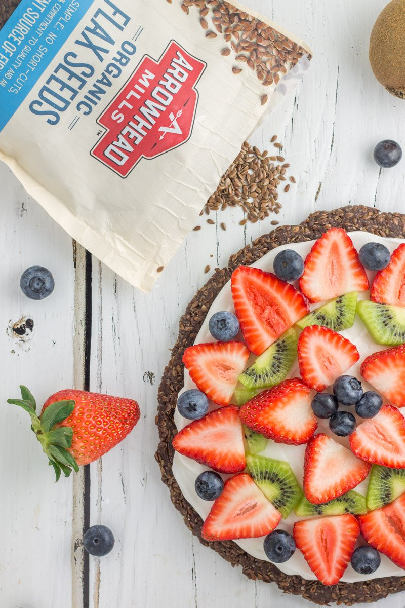 Gluten free, dairy free fruit pizza with a nut-free crust. The perfect no bake, paleo dessert!