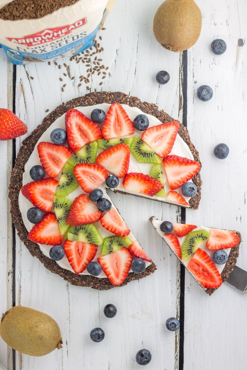 This healthy, paleo fruit pizza has a nut-free cocoa crust and a delicious coconut whip cream