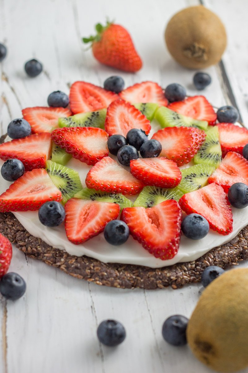 This paleo fruit pizza is made with no bake flaxseed crust. Dairy free, gluten free, refined sugar free