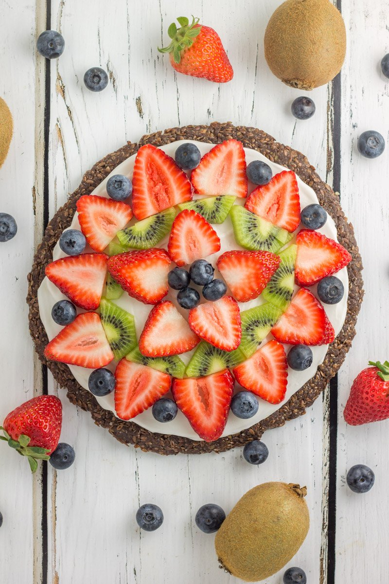 This paleo, no bake fruit pizza has a rich cocoa crust, topped with fresh fruit. A perfect summer dessert that's healthy too!