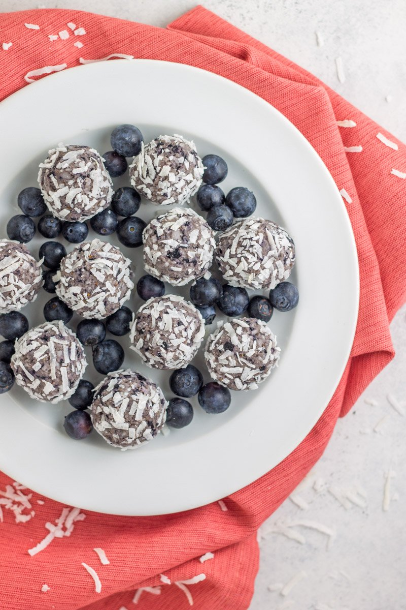 Healthy blueberry bliss balls made with fresh blueberries, cashew butter, and coconut! Paleo & Vegan