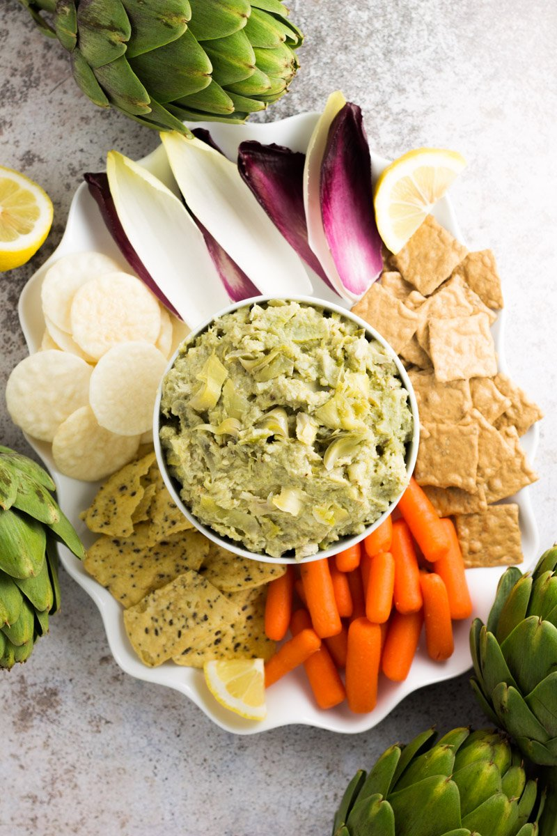 This skinny artichoke dip is full of big flavor without the use of mayo, sour cream, or cheese! It's paleo and Whole30 compliant!