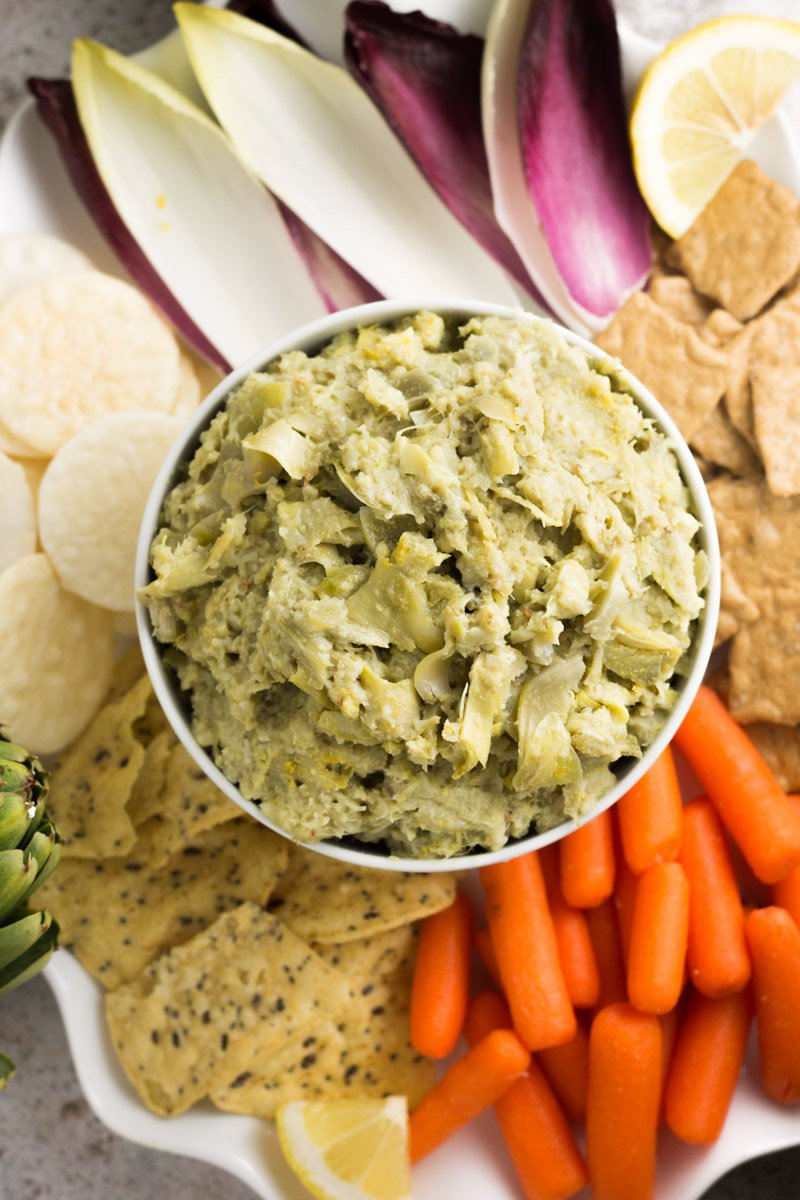 This skinny paleo artichoke dip is packed with flavor, and low calorie! No mayo or cheese. Dairy free and gluten free. A great Whole30 recipe too!