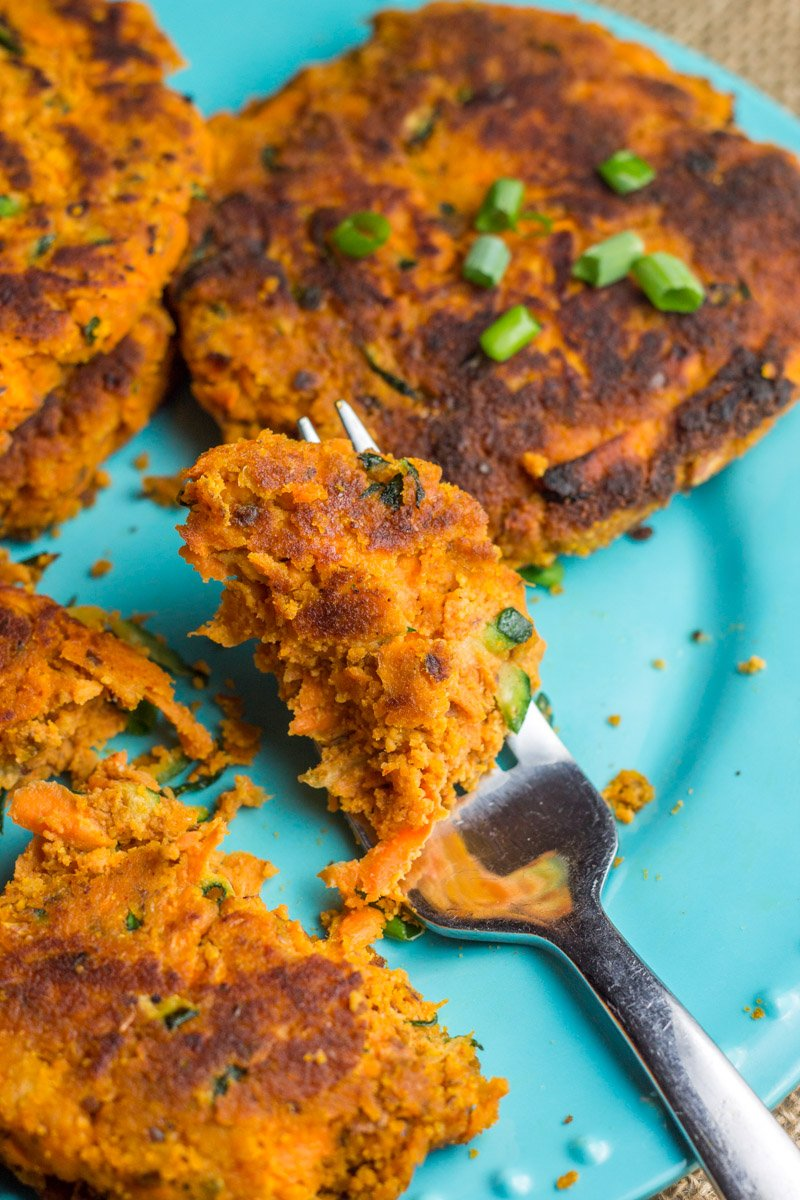 Squeaky clean and super healthy, these sweet potato burgers are made with grated and mashed sweet potato and grated zucchini. Paleo and Whole30