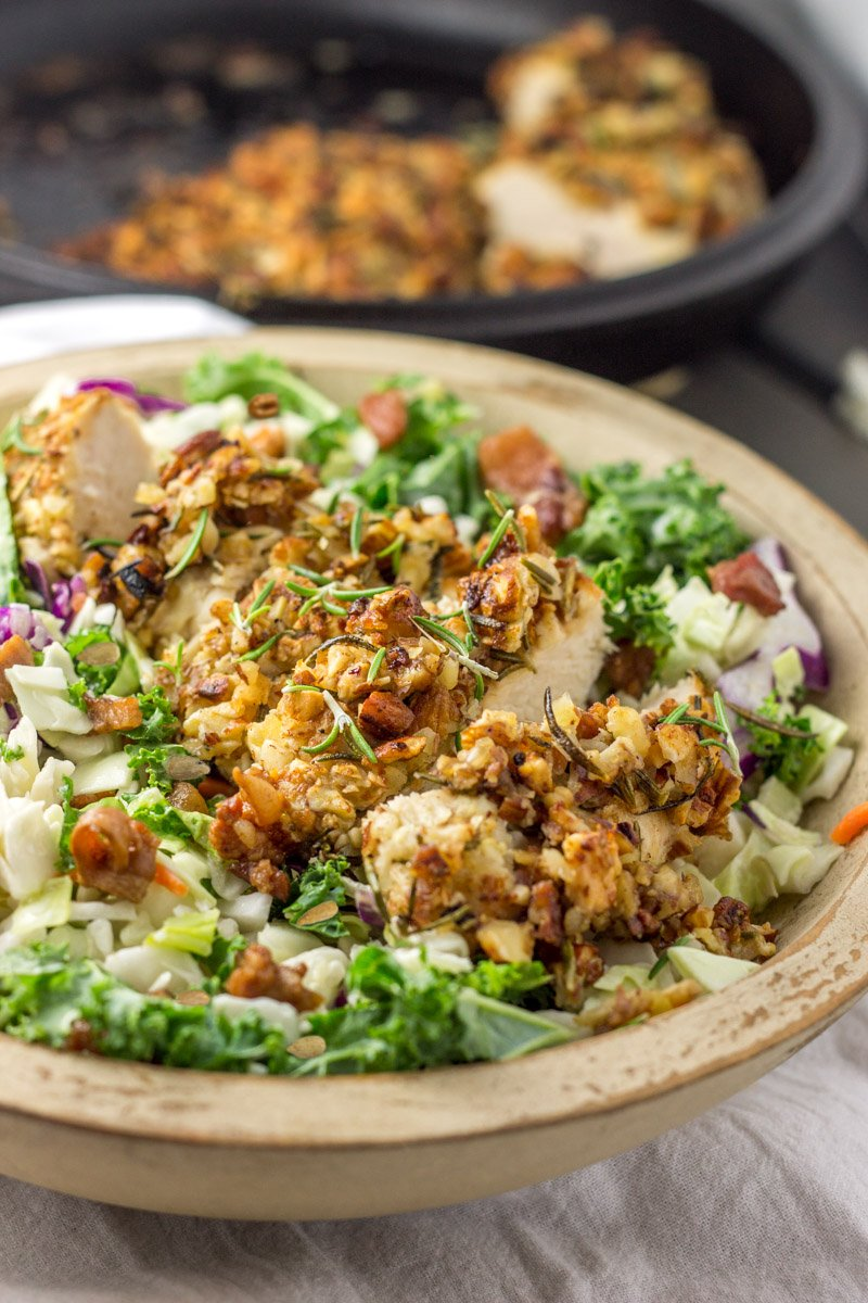 Almond crusted chicken with fresh rosemary and dried onion over a bed of chopped lettuce makes the perfect healthy lunch or dinner