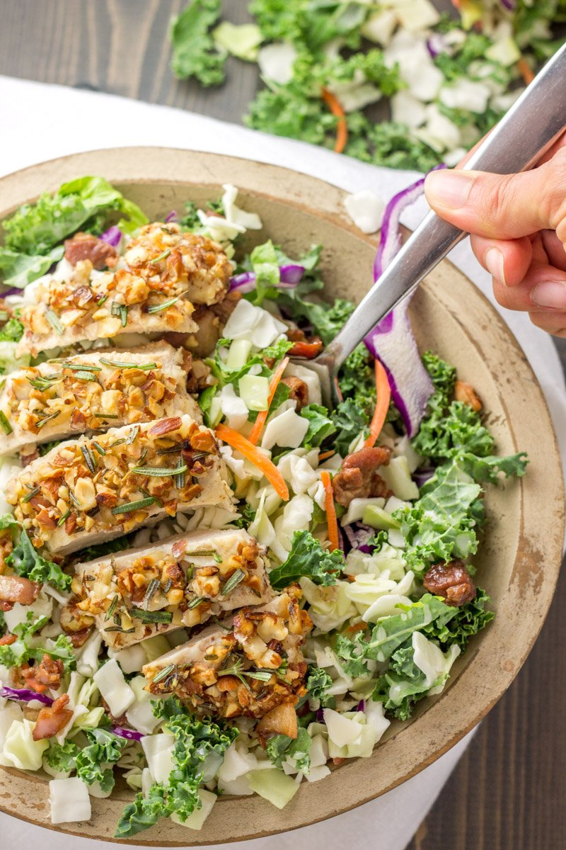 This paleo and whole30 rosemary almond crusted chicken is crunchy, juicy, and perfect over salad!
