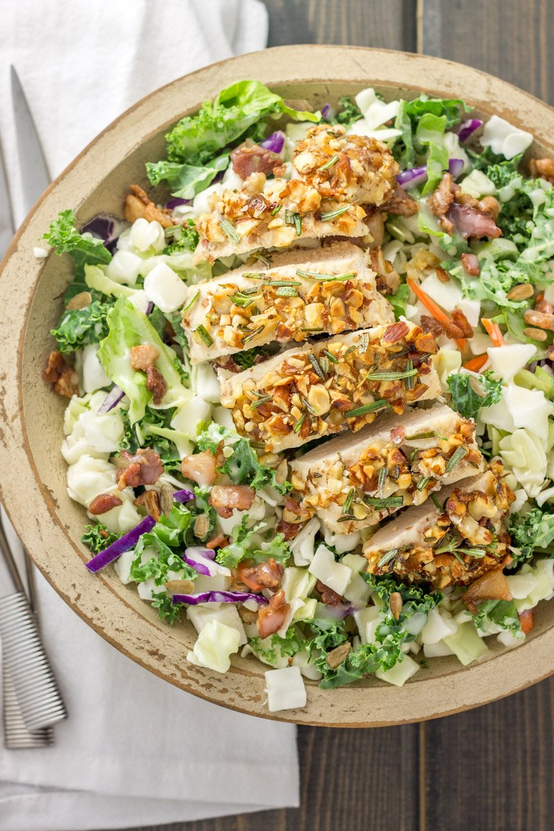 This healthy and flavorful rosemary almond crusted chicken is perfect over a chopped salad!